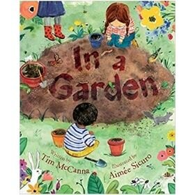 earth day books, in a garden.jpg